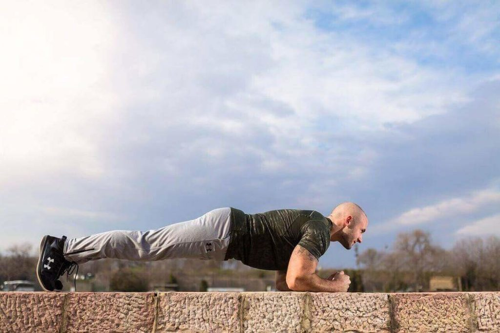 a man is doing plank